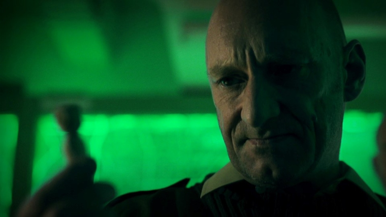 This guy commands every scene he's in. Which is good, because he plays the bunker's Commander.